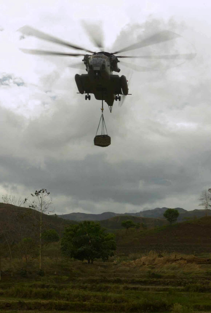 A US Marine Corps (USMC) CH-53E Sea Stallion helicopter with Heavy Marine Helicopter Squadron 466 (HMM-466), drops off crates of M198 Towed Howitzer ammunition rounds for the 11th Field Artillery Regiment, in support of Exercise BALIKATAN