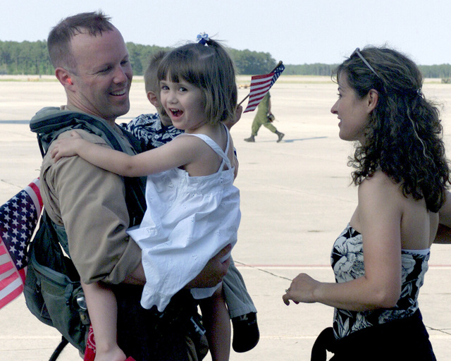 Captain (CAPT) Pierson MacNaughton, an EA-6B Prowler pilot for the Marine Tactical Electronic Warfare Squadron (VMAQ-1), is greeted by his wife Holly, daughter Paxton and son Charles during his homecoming on Marine Corps Air Station (MCAS) Cherry Point, North Carolina