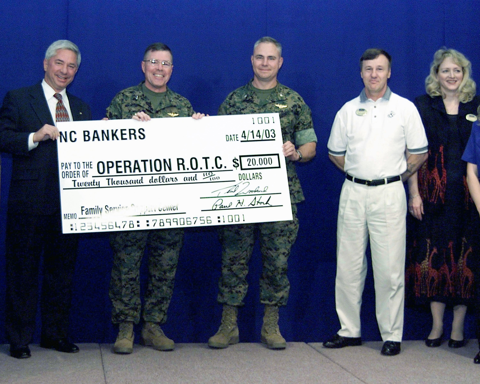 Thad Woodard, President of the North Carolina Bankers Association, presents a check for $20,000 to Major General (MGEN) Flannagen, Commanding General (CG) of Cherry Point, Marine Corps Air Bases Eastern Area and Lieutenant Colonel (LTCOL) Karl S. Elebash, Executive Officer (EO) of Marine Corps Air Station (MCAS) at New River