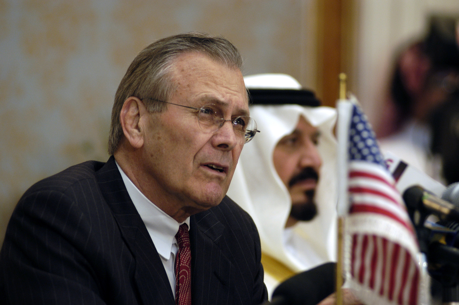 The Honorable Donald H. Rumsfeld (front), U.S. Secretary of Defense, answers a reporter's question, during a joint media availability session with His Royal Highness Prince Sultan bin Abdul Aziz Al Saud (back), Minster of Defence and Aviation for the Kingdom of Saudi Arabia, in the city of Riyadh, Riyadh (Ar Riyad) Province, Kingdom of Saudi Arabia, on April 29, 2003, while Secretary Rumsfeld is on an official seven day tour of the region.  OSD Package No. A07D-00575 (DOD PHOTO by Helene C. Stikkel) (Released)