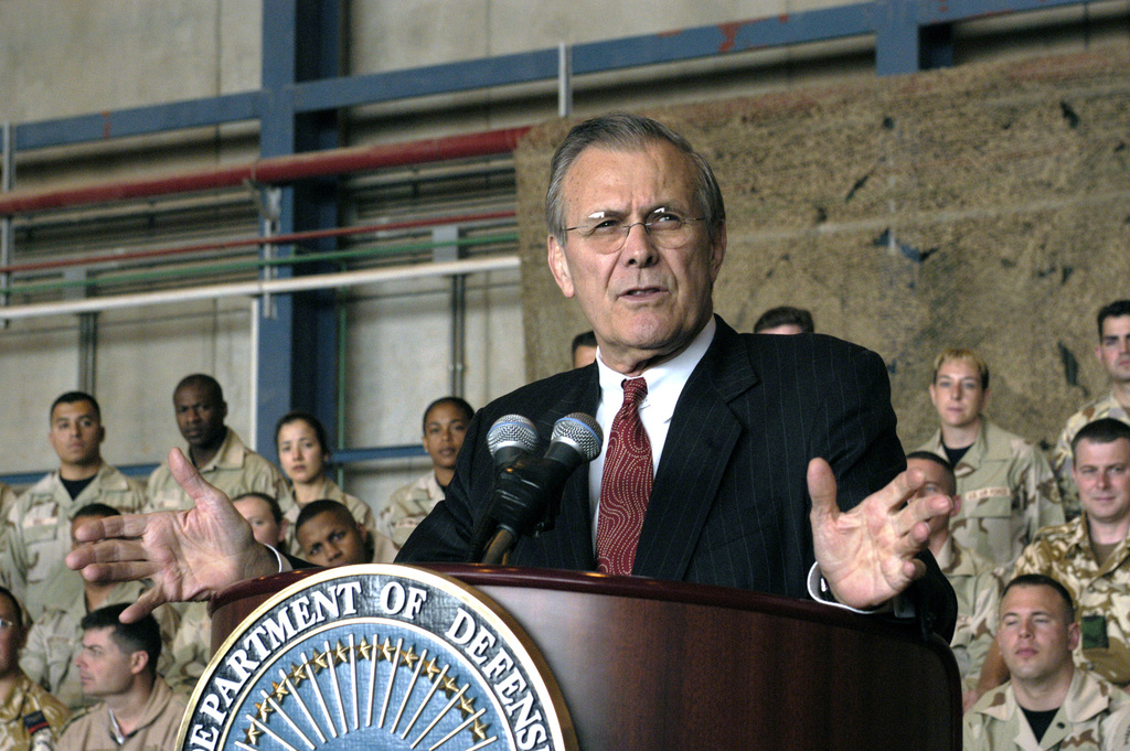 The Honorable Donald H. Rumsfeld, U.S. Secretary of Defense, answers questions from U.S. military personnel during a town hall meeting at Prince Sultan Air Base, in the city of Al Kharj, Riyadh (Ar Riyad) Province, Kingdom of Saudi Arabia, on April 29, 2003, while on an official seven day tour of the region. (DoD photo by Helene C. Stikkel) (Released)