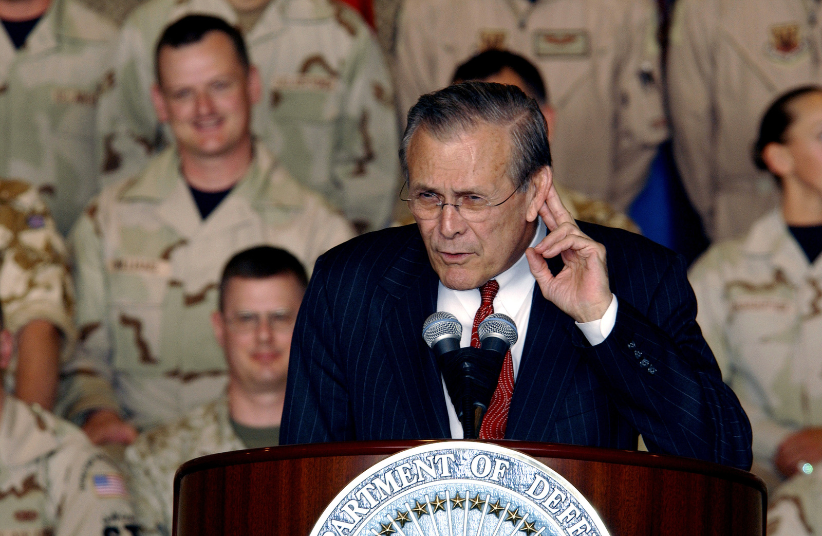 The Honorable Donald H. Rumsfeld, U.S. Secretary of Defense, listens attentively to a question during the question and answer period at the end of his talk to coalition forces, currently stationed at Prince Sultan Air Base, Saudi Arabia, participating in Operation Iraqi Freedom, on April 29, 2003. (DoD photo by MASTER SGT. Michael E. Best) (Released)