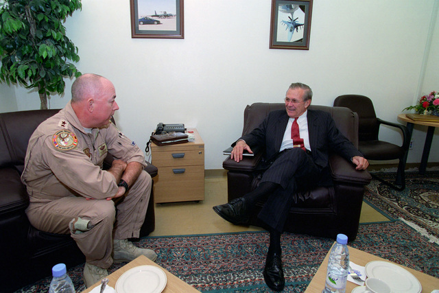 """U.S. Air Force LT. GEN. T. Michael""""Buzz""""Moseley (left), Commander, Combined Forces Air Component Command (CFACC), meets with U.S. Secretary of Defense, Donald H. Rumsfeld, during the Secretary's visit at Prince Sultan Air Base, Saudi Arabia, on April 29, 2003.  OSD Package No. A07D-00577 (DOD PHOTO by Helene C. Stikkel) (Released)"""