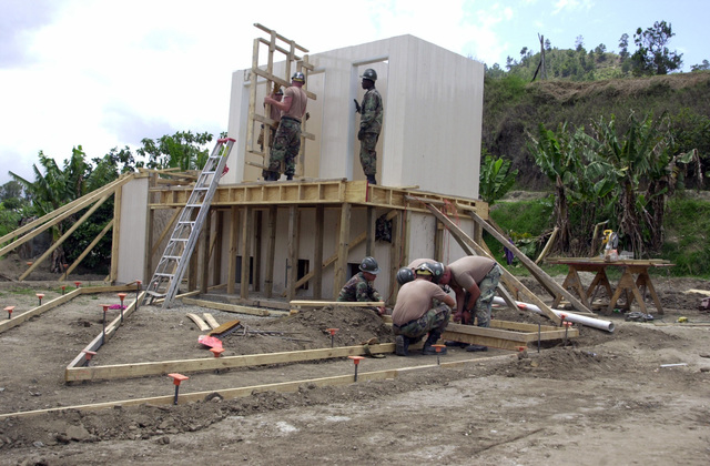 U.S. Navy Sailors, Naval Mobile Construction Battalion 133, Gulfport, Miss., work on a two-story latrine at the Arroyo Arriba School House in Costanza, Dominican Republic, on April 29, 2003, during New Horizons 03. (U.S. Army photo by Miguel A. Negron) (Released)