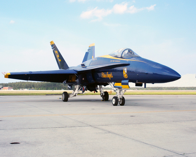 "An US Navy (USN) F/A-18 Hornet aircraft assigned to the USN ""Blue Angels"" Aerial Demonstration Team, parked on the ramp at Marine Corps Air Station (MCAS), Cherry Point, North Carolina (NC)"