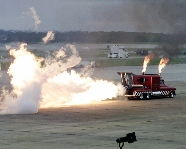 "The ""Super Shockwave"" a 25,000-Horse Powered (HP) jet-engine modified truck, owned by Les Shockley Jet Shows, performs during an air show at Marine Corps Air Station (MCAS), Cherry Point, North Carolina (NC)"
