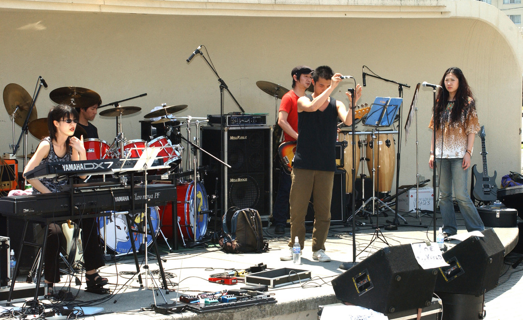 A band prepares for its performance during Friendship Day, as part of the entertainment provided for an annual event held at Marine Corps Air Station (MCAS) Iwakuni, Japan, to celebrate the friendship between Japanese and Americans. Some of the events include an air show, static displays, live bands and a variety of food booths, including Japanese and American food