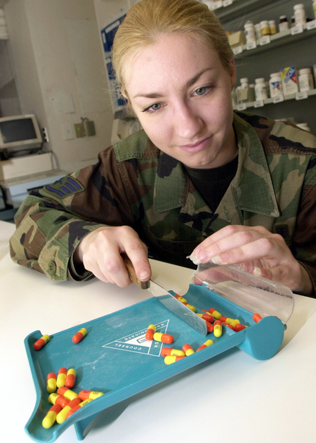 US Air Force (USAF) STAFF Sergeant (SSGT) Ida Punzo, Pharmacy Technician, 31st Medical Support Squadron (MSS) fills a prescription, inside the pharmacy at Aviano Air Base (AB), Italy