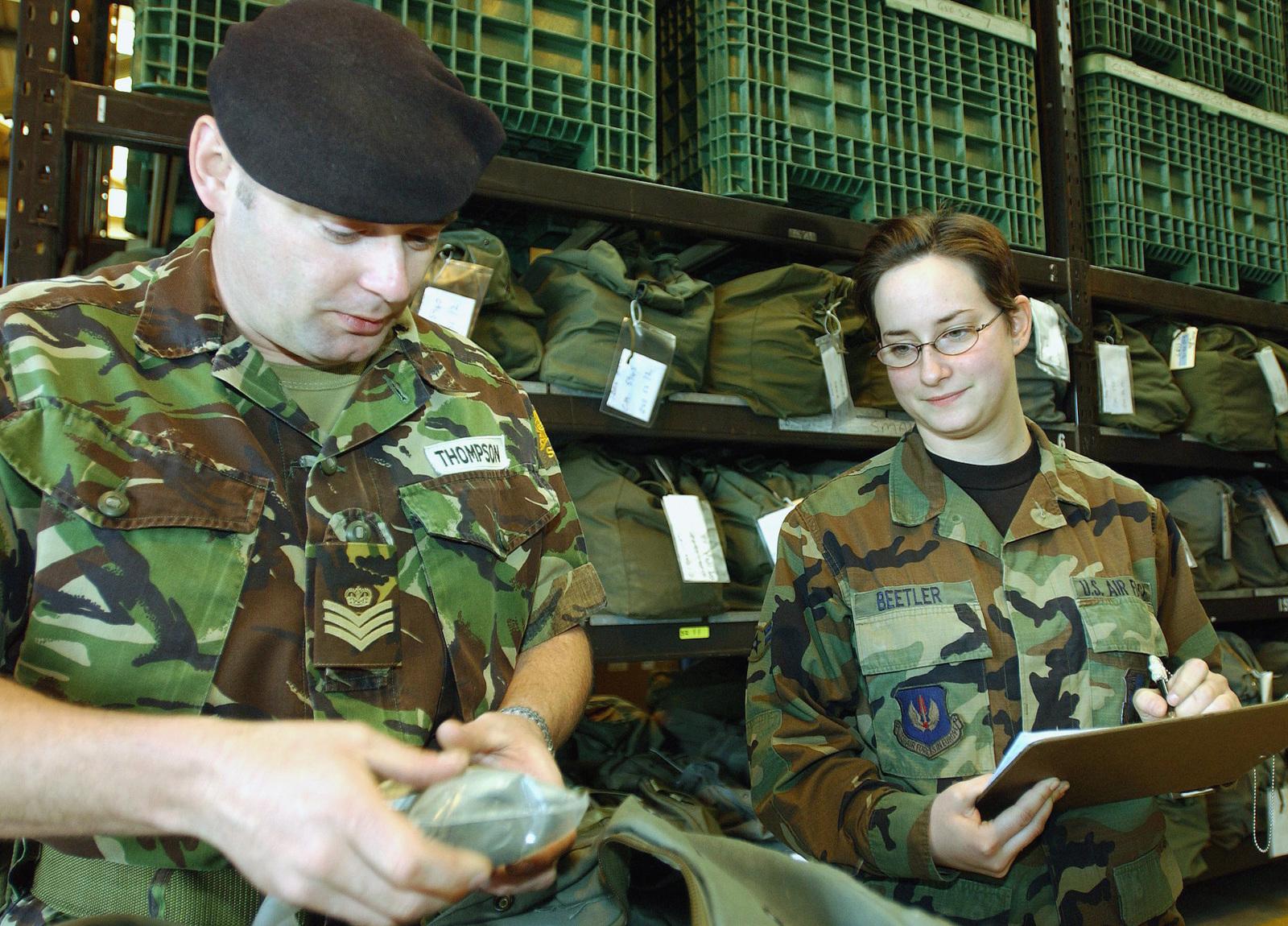Royal Army (British) STAFF Sergeant (SSGT) Kelvyn Thompson (left), Squadron  Quarter MASTER Sergeant, 126th Petroleum Squadron,