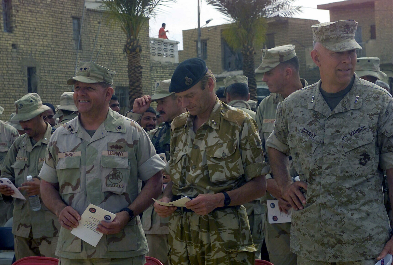 High ranking US Military and British (UK) Army Officers on hand for the Ceremony to rededicate the World War I (WWI) era British Cemetery, located in Al Kut, Iraq, during Operation IRAQI FREEDOM. Pictured foreground left-to-right, US Navy (USN) Rear Admiral (RAMD) Charles R. Kubic, Commander, First Naval Construction Division, US Atlantic Fleet/Commander, Naval Construction Forces Command; British Army Major General (MGEN) Robin Brimms, Commander, British 1ST Armored Division; and US Marine Corps (USMC) Lieutenant General (LGEN) James T. Conway, Commanding General, 1ST Marine Expeditionary Force (MEF)