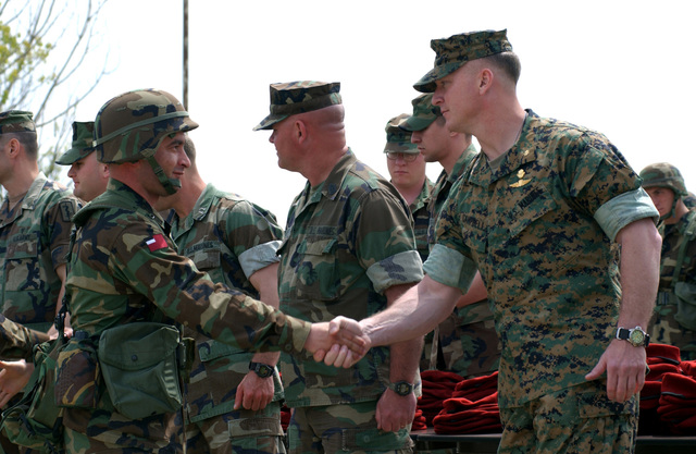 A Republic of Georgia Army Soldier assigned to the 16th Mountain Battalion, gets a handshake and congratulation from US Marine Corps (USMC) Major (MAJ) Scott Campbell, Commanding Officer, Task Force Georgia Train and Equip Program (GTEP), after completing the third tactical training phase of the program, during a Certification Ceremony held at the Krtsanisi Training Area, Rock City, Georgia. GETEP is a phased training initiative that enhances operational capabilities of select Georgian units to increase security of Georgia's borders and promote stability within the region