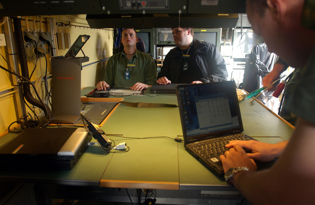 Members of the Belgium Army contingent, tests connectivity between a phone line and a fax machine during Exercise COMBINED ENDEAVOR 2003. The Exercise is a Partnership for Peace (PfP) exercised hosted by Germany, and is the largest information and communications systems exercise in the world which focuses primarily on Command, Controls, Communications, and Computers (C4), interoperability testing and documentation