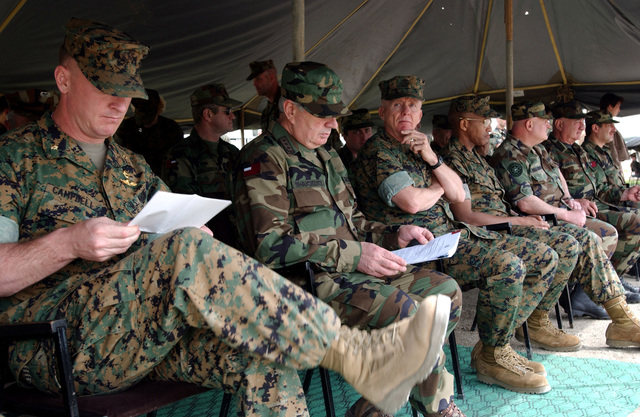 US Marine Corps (USMC) Major (MAJ) Scott Campbell (foreground), Commanding Officer, Task Force Georgia Train and Equip Program (GTEP), reviews his notes prior to the start of a Certification Ceremony, held at Rock City, Georgia. The ceremony marks the completion of the third tactical training phase, for Republic of Georgia Army Soldier from the 16th Mountain Battalion, participating in the program. GETEP is a phased training initiative that enhances operational capabilities of select Georgian units to increase security of Georgia's borders and promote stability within the region