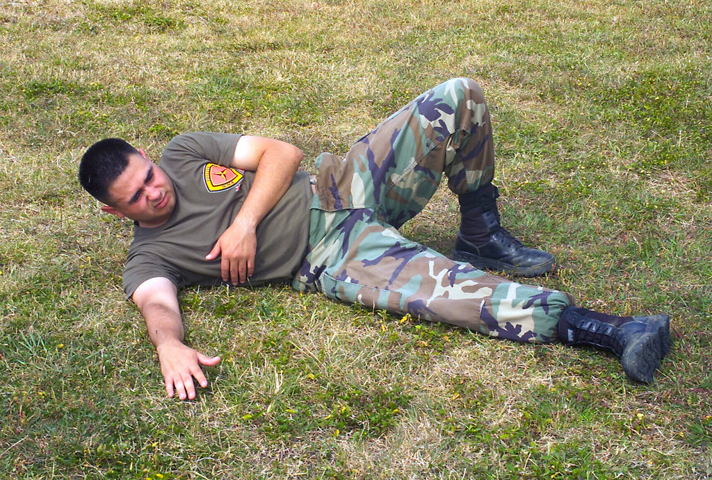 US Marine Corps (USMC) Corporal (CPL) Joe Villegas, a Videographer assigned to Combat Visual Information Center (CVIC), practices fall-breaking techniques during a tan belt instructions course, part of the Marine Corps Martial Arts Program (MCMAP) at Camp Foster, Okinawa, Japan