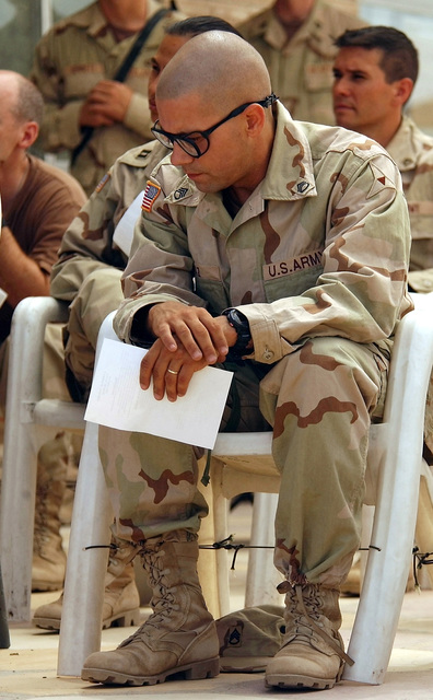 US Army (USA) STAFF Sergeant (SSG) Michael Paz, 300th Battalion Battle, Non-Commissioned Officer (NCO), attends a Catholic Mass at the Convoy Supply Center (CSC) located in Scania, Iraq, during Operation IRAQI FREEDOM