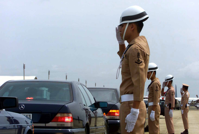 Members of the Royal Thailand Armed Forces Military Police salute as dignitaries from participating countries leave by motorcade, at the Utapao National Airport, Thailand, during the opening ceremony for Exercise COBRA GOLD 2003