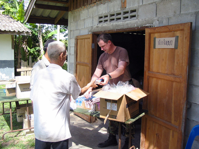 A US Army (USA) Medical Officer assigned to 2nd Battalion, 1ST Special Forces Group (SFG) Airborne, distribute medical prescriptions and vitamins to the local Thai villagers during the Medical Community Assistance Program (MEDCAP) at Ban Dong, Thailand, during Exercise COBRA GOLD 2003