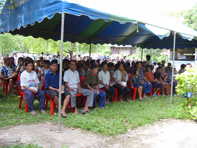 Local Thai villagers sit underneath a tent while waiting to see US Army (USA) Medical Doctors during the Medical Community Assistance Program (MEDCAP) at Ban Dong, Thailand, during Exercise COBRA GOLD 2003