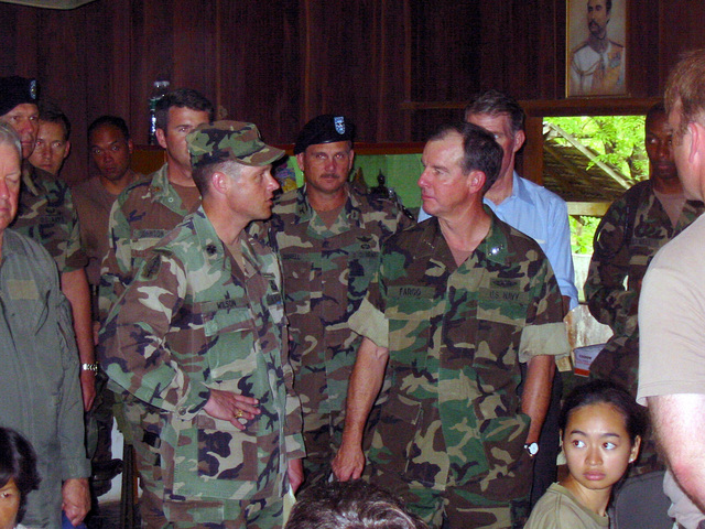 US Navy (USN) Admiral (ADM) Thomas Fargo (foreground right), Commander, US Pacific Command, visits with US Army (USA) Medical Officer of the 2nd Battalion, 1ST Special Forces Group, during his visit to the Medical Community Assistance Program (MEDCAP) at Ban Dong, Tambol Ban Laeng Province, Thailand, during Exercise COBRA GOLD 2003