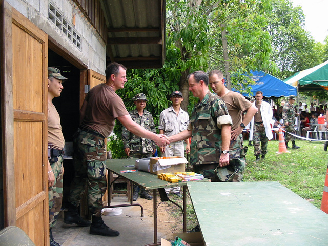 US Navy (USN) Admiral (ADM) Thomas Fargo (right), Commander, US Pacific Command, meets US Army (USA) soldiers assigned to 2nd Battalion, 1ST Special Forces Group, while visiting the Medical Community Assistance Program (MEDCAP) at Ban Dong, Thailand, during Exercise COBRA GOLD 2003