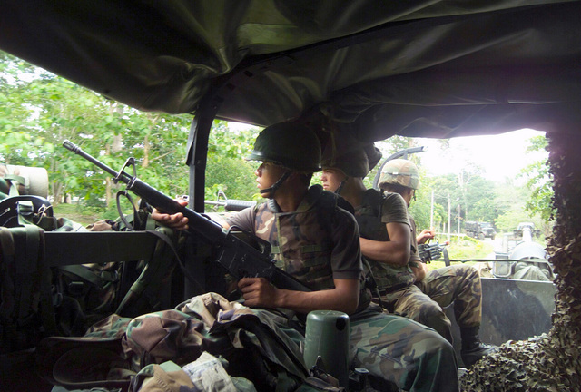 US Marine Corps (USMC) Lance Corporal (LCPL) Scott Dobson and LCPL Michael Stephens, S/Battery, 5th Battalion, 10th Marines, armed with 5.56mm M16A2 rifles provide convoy security, as the unit transport its M198, 155mm Towed Howitzer at Pong Nam Ran, Thailand, during Exercise COBRA GOLD 2003