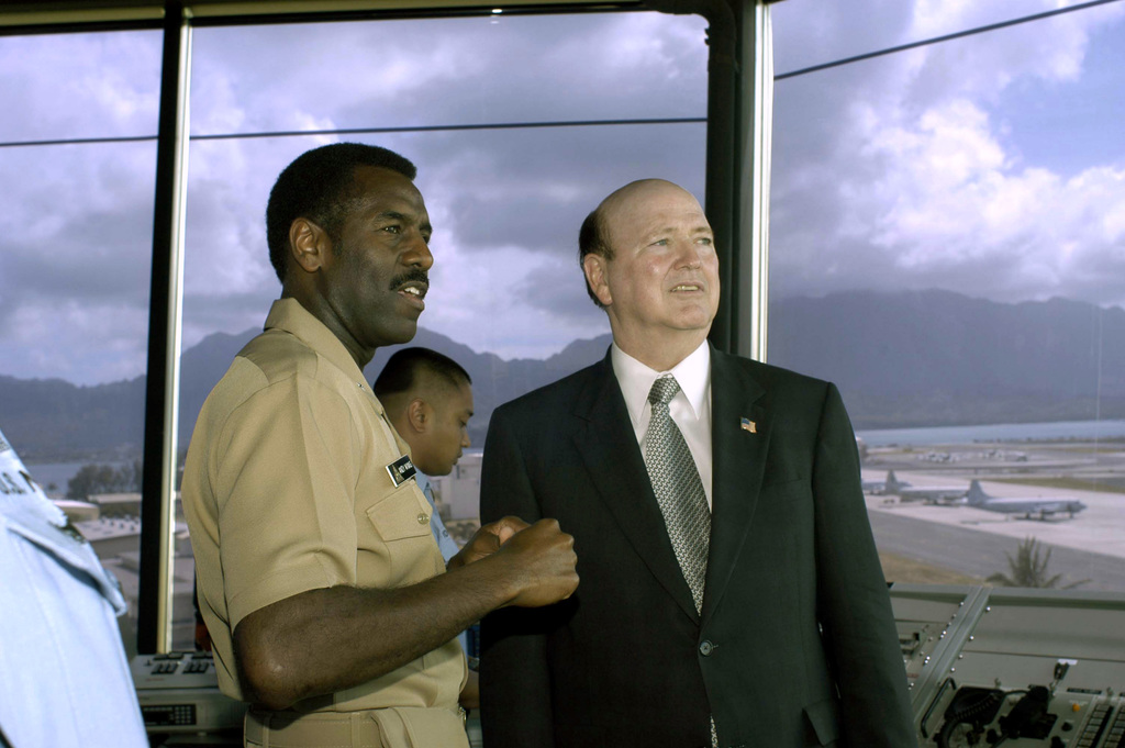 US Navy (USN) Rear Admiral (RADM) Anthony L. Winns (left), Commander, Patrol and Reconnaissance Force, US Pacific Fleet, talks with the acting Secretary of the Navy (SECNAV) The Honorable Hansford T. Johnson, during a tour of the Air Traffic Control Center (ATC) aboard the Marine Corps Base (MCB) Kaneohe Bay, Hawaii (HI)