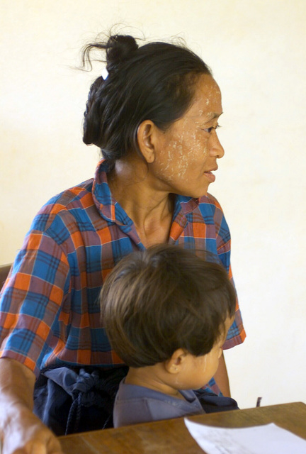 A local Thai mother and child wait to be examined during the Medical Community Assistance Program (MEDCAP) operated by US Navy Reserve (USNR) personnel, in a village near the Thai border during Exercise COBRA GOLD 2003