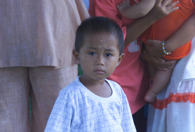 A small Thai boy waits to be examined during the Medical Community Assistance Program (MEDCAP) operated by US Navy Reserve (USNR) personnel, in a village near the Thai border during Exercise COBRA GOLD 2003