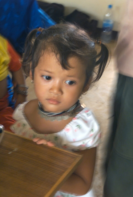 A small Thai girl waits to be examined during the Medical Community Assistance Program (MEDCAP) operated by US Navy Reserve (USNR) personnel, in a village near the Thai border during Exercise COBRA GOLD 2003