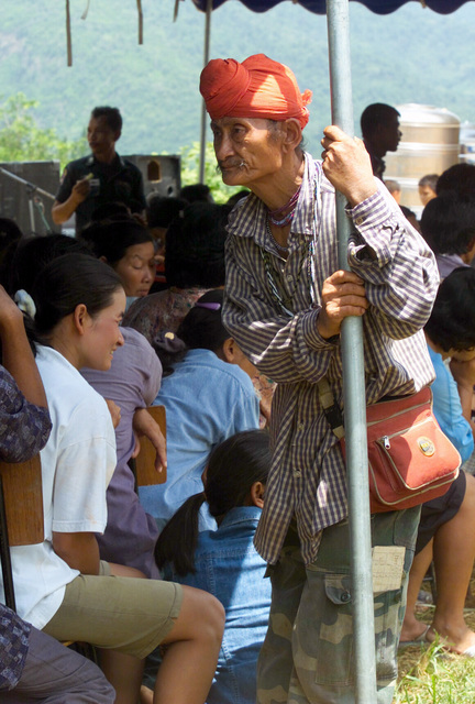 An elderly Thai man waits with other local villagers to be examined during the Medical Community Assistance Program (MEDCAP) operated by US Navy Reserve (USNR) personnel, in a village near the Thai border during Exercise COBRA GOLD 2003