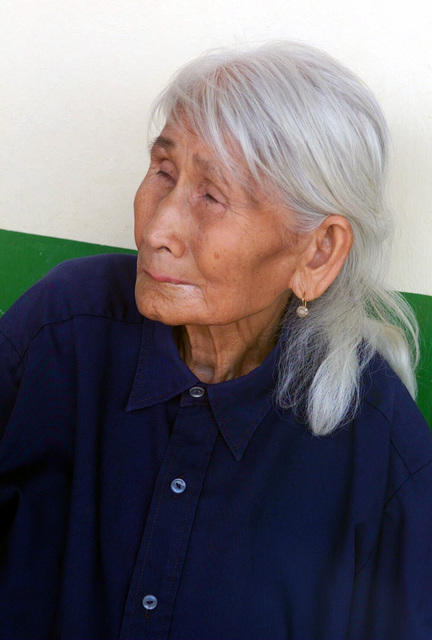 An elderly Thai woman waits to be examined during the Medical Community Assistance Program (MEDCAP) operated by US Navy Reserve (USNR) personnel, in a village near the Thai border during Exercise COBRA GOLD 2003