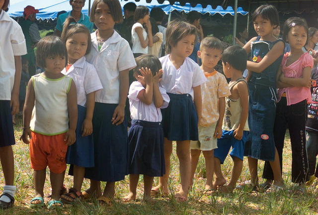 Local Thai children wait in line to receive balloon animals, and free medical attention given as part of the Medical Community Assistance Program (MEDCAP) operated by US Navy Reserve (USNR) personnel, in a village near the Thai border during Exercise COBRA GOLD 2003