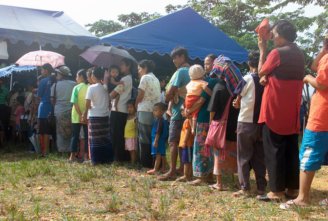 Local Thai villagers wait in line for medical attention during the Medical Community Assistance Program (MEDCAP) operated by US Navy Reserve (USNR) personnel, in a village near the Thai border during Exercise COBRA GOLD 2003