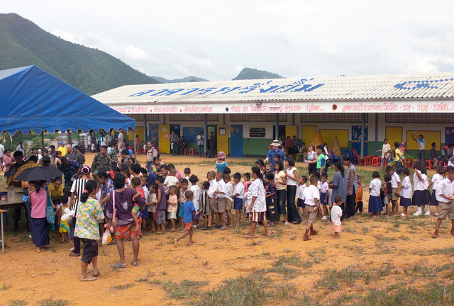 Local Thai villagers wait in line to receive a free medical attention, during the Medical Community Assistance Program (MEDCAP) operated by US Navy Reserve (USNR) personnel, in a village near the Thai border during Exercise COBRA GOLD 2003