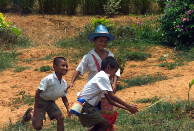 Three Thai boys run and play together after being examined during the Medical Community Assistance Program (MEDCAP) operated by US Navy Reserve (USNR) personnel, in a village near the Thai border during Exercise COBRA GOLD 2003