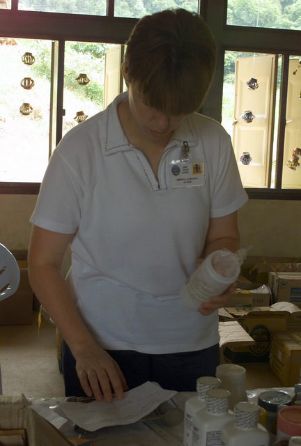 US Navy (USN) Hospital Corpsman 2nd Class (HM2) Christine Ellis, fills free prescriptions local Thai people, after they have been evaluated by USN Doctors, during the Medical Community Assistance Program (MEDCAP) operated by US Navy Reserve (USNR) personnel, in a village near the Thai border during Exercise COBRA GOLD 2003