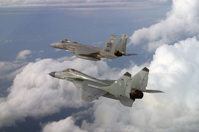 "A Russian designed MiG-29 fighter flown by German Luftwaffer pilot Lieutenant Colonel (LCOL) Tom Hahn, Squadron Commander (SC) of Germany's (DEV) 73rd Fighter Wing (FW) or ""Steinhoff,"" stays in formation with a US Air Force (USAF) F-15C Eagle piloted by Major (MAJ) Greg Thomas, from the 28th Test Squadron (TS), Nellis Air Force Base (AFB), Nevada, over the state of Florida during a joint training exercise"