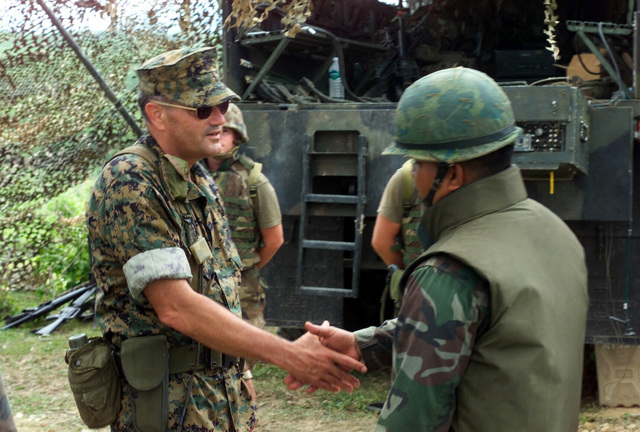 US Marine Corps (USMC) Major General (MGEN) Joseph F. Weber (left), Commanding General, 3rd Marine Division, greets a MASTER Sergeant from the Royal Thai Marines during the Generals visit with USMC Marines from S/Battery, 5th Battalion, 10th Marines, at Gun Position 10, Pong Nam Ran, Thailand, during Exercise COBRA GOLD 2003