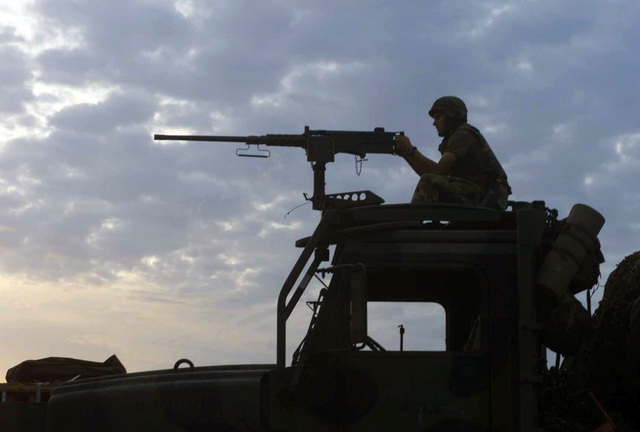 US Marine Corps (USMC) Lance Corporal (LCPL) Zach Campbell, assigned to Sierra/Battery, 5th Battalion, 10th Marines, mans an M2HB 0.50 caliber machine gun, mounted atop a MK-23 Medium Tactical Vehicle Replacement (MTRV) 7-ton cargo truck, while providing security during a live fire exercise at Gun Position 10, Pong Nam Ran, Thailand, during Operation COBRA GOLD. The exercise is an annual multi-national training exercise designed to ensure regional peace and strengthen the ability of the Royal Thai Armed Forces