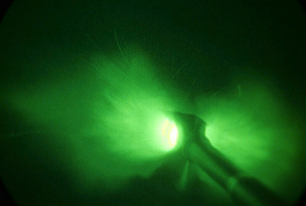 Light enhanced photography showing a close up view of the muzzle blast from a US Marine Corps (USMC) M198 155mm Howitzer operated by S/Battery, 5th Battalion, 10th Marines, during a night live fire exercise at Gun Position 10, Pong Nam Ran, Thailand, during Exercise COBRA GOLD 2003
