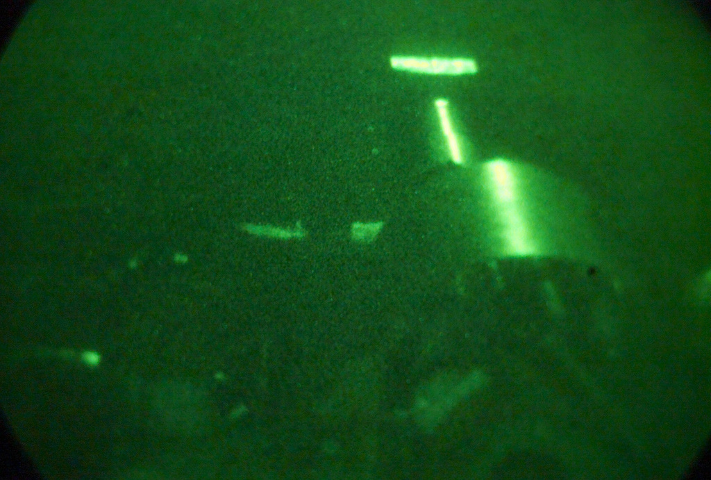 Light enhanced photography showing a US Marine Corps (USMC) M198 155mm Howitzer operated by S/Battery, 5th Battalion, 10th Marines, during a night live fire exercise at Gun Position 10, Pong Nam Ran, Thailand, during Exercise COBRA GOLD 2003