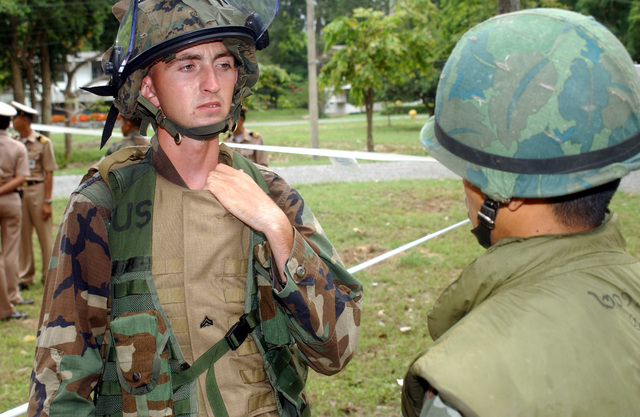 US Marine Corps (USMC) Corporal (CPL) Mathew Solmmes, left and Royal Thai Marine (CHIEF PETTY Officer First Class) PO1 Wattanapan Chantarasaen, consult on tactics in order to protect Evacuees during a Non-Combatant Evacuation Operation (NEO), part of Exercise COBRA GOLD 2003. Corporal (CPL) Mathew Solmmes, is attached to the 1ST Battalion, 3rd Marines, from Kaneohe Bay, Hawaii