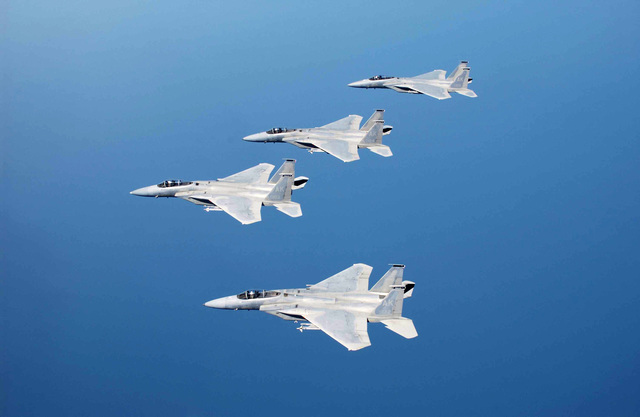 These US Air Force (USAF) F-15C Eagle fighters in formation are from the 19th Fighter Squadron (FS), Elmendorf Air Force Base (AFB), Alaska, as they fly over the Gulf of Mexico during a joint training exercise, known as Combat Archer
