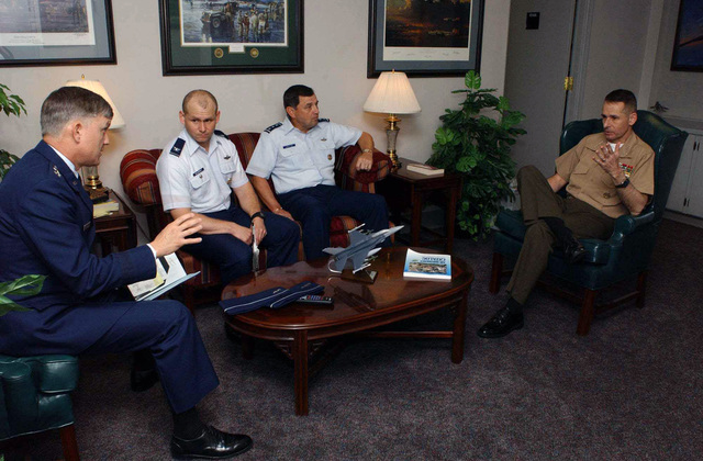 US Air Force (USAF) Lieutenant General (LGEN) Donald A. Lamontagne, second from right, Commandant Air University (AU/CC), listens to Vice Chairman of the Joint Chiefs of STAFF (VJC) US Marine Corps (USMC) General (GEN) Peter Pace, while USAF Major General (MGEN) Bently Rayburn, left, Commander, Air War College (AWC/CC), briefs a guest speaker prior to the start of the 50th Annual National Security Forum (NSF), held at the Air War College (AWC), Maxwell Air Force Base (AFB), Alabama (AL)