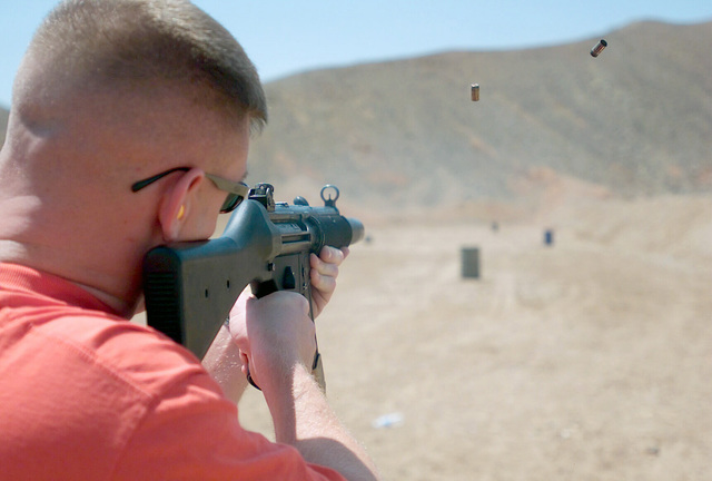 US Marine Corps (USMC) First Lieutenant (1LT) Brett Miner, Headquarters and Headquarters Squadron, fires a 9mm MP5 Heckler and Koch submachine gun, while attending a period foreign military small arms weapons course at Adair MCAS) Yuma, Arizona (AZ)
