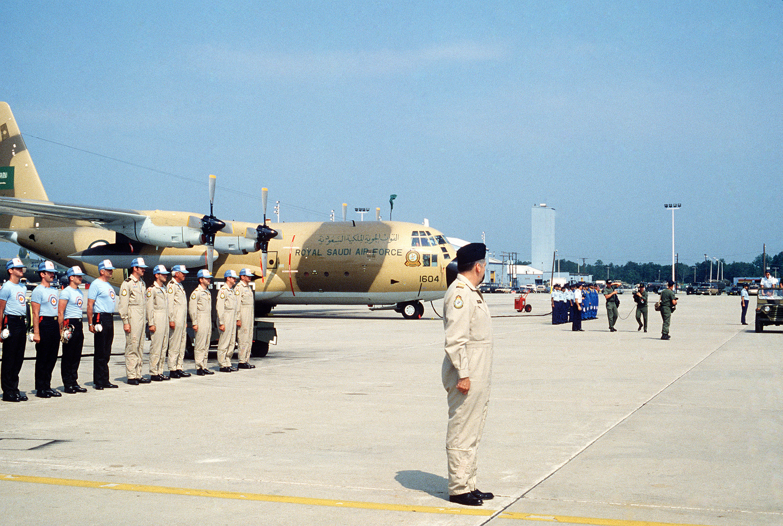 The Canadian Team Participating In Volant Rodeo 84 Tactical Bundling 1 Navy M Airdrop Competition Stands At Attention Front Of Their Cc 130 Aircraft Waiting To Be