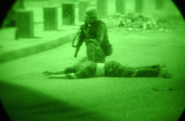 US Army (USA) STAFF Sergeant (SSG) Billy Stephens, 204th Military Police (MP) Company, apprehends a citizen for illegal possession of a firearm in Baghdad, Iraq, during Operation IRAQI FREEDOM