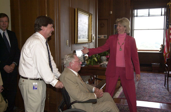 Secretary Gale Norton, right, with Judge Paul Brown, center, father of the late astronaut David Brown, before Department of Interior headquarters ceremony marking the naming of Columbia Point, a 13,980-feet peak in Colorado's Sangre de Cristo Mountains, in honor of Space Shuttle Columbia's last voyage