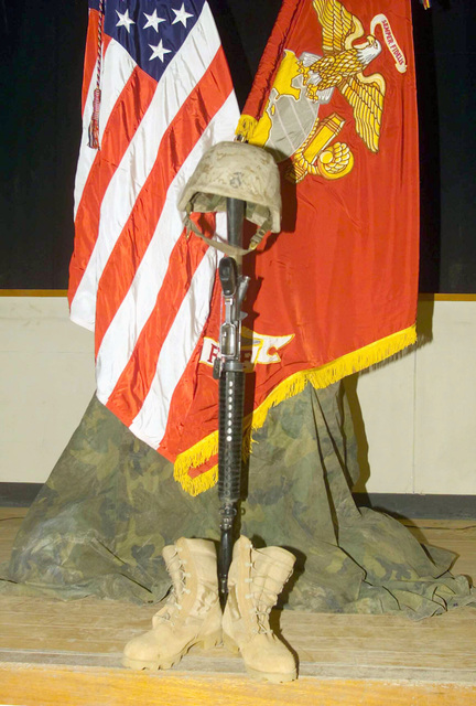 A Fallen Marine Memorial honoring US Marine Corps (USMC) Private First Class (PFC) Ryan R. Cox, 1ST Battalion, 7th Marine Regiment, 1ST Marine Division. PFC Cox died as a result of wounds received from a non-combat weapon discharge near An Najaf, Iraq, during Operation IRAQI FREEDOM