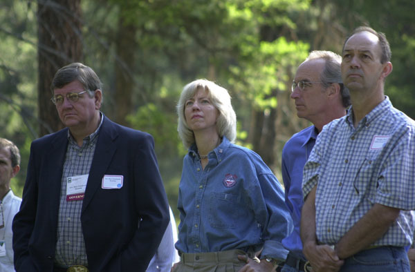 Wyoming Governor Dave Freudenthal, Secretary Gale Norton, and Idaho Governor Dirk Kempthorne, left to right, among the dignitaries on hand for the Western Governors' Association Forest Health Summit in Missoula, Montana, and for related tours of the area, including visit to the Lubrecht Experimental Forest, managed in part by the University of Montana
